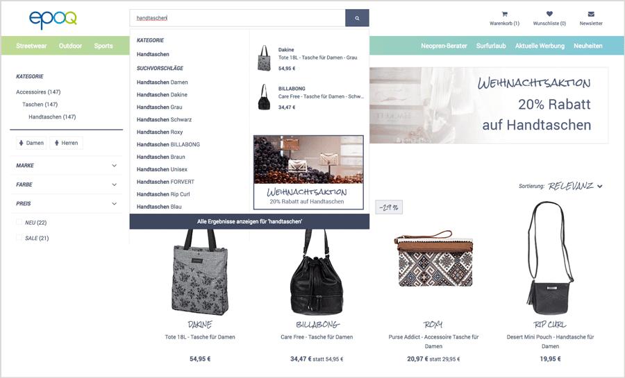 """Das Bild zeigt den Autosuggest für den Suchbegriff """"handtaschen"""" mit integriertem Banner."""
