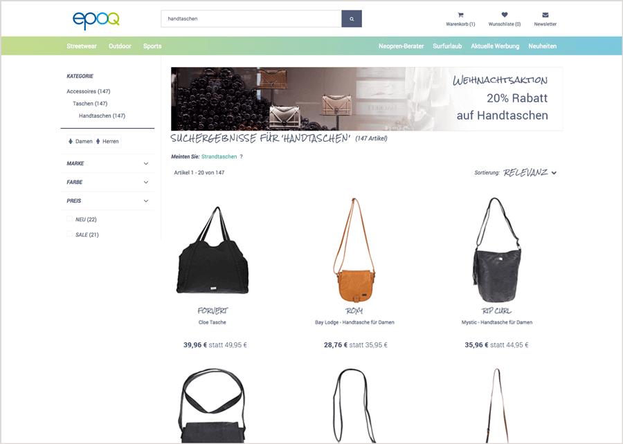 """Das Bild zeigt die Ergebnisliste mit integriertem Banner für die Weihnachtsaktion zum Suchbegriff """"handtaschen""""."""
