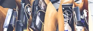Prall gefüllte Einkaufstüten zeigen den Erfolg durch Emfpehlungsstrategien. Das Wissen darüber kann in Events angeeignet werden.